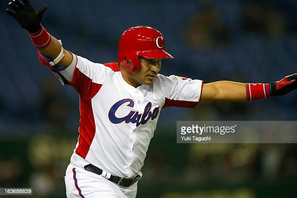 Frederich Cepeda of Team Cuba reacts to hitting a two run home run in the bottom of the first inning during Pool 1 Game 3 between the Chinese Taipei...