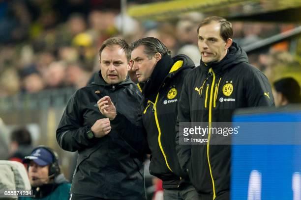 Frederick Assmuth speak with Director of Sports Michael Zorc of Dortmund and Head coach Thomas Tuchel of Dortmund during the Bundesliga match between...