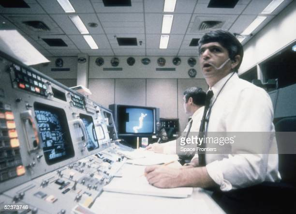 Frederick Gregory and Richard O Covey spacecraft communicators at Mission Control in Houston watch helplessly as the Challenger shuttle explodes on...