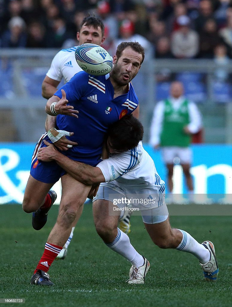 Frederick Michalak of France drops the ball as he is tackled during the RBS Six Nations match between Italy and France at Stadio Olimpico on February 3, 2013 in Rome, Italy.