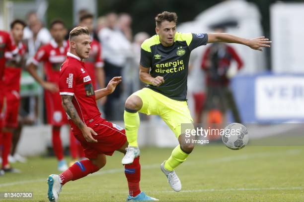 Frederico Dimarco of FC Sion Santiago Arias of PSV during the friendly match between FC Sion and PSV Eindhoven at Stade StMarc on July 12 2017 in...