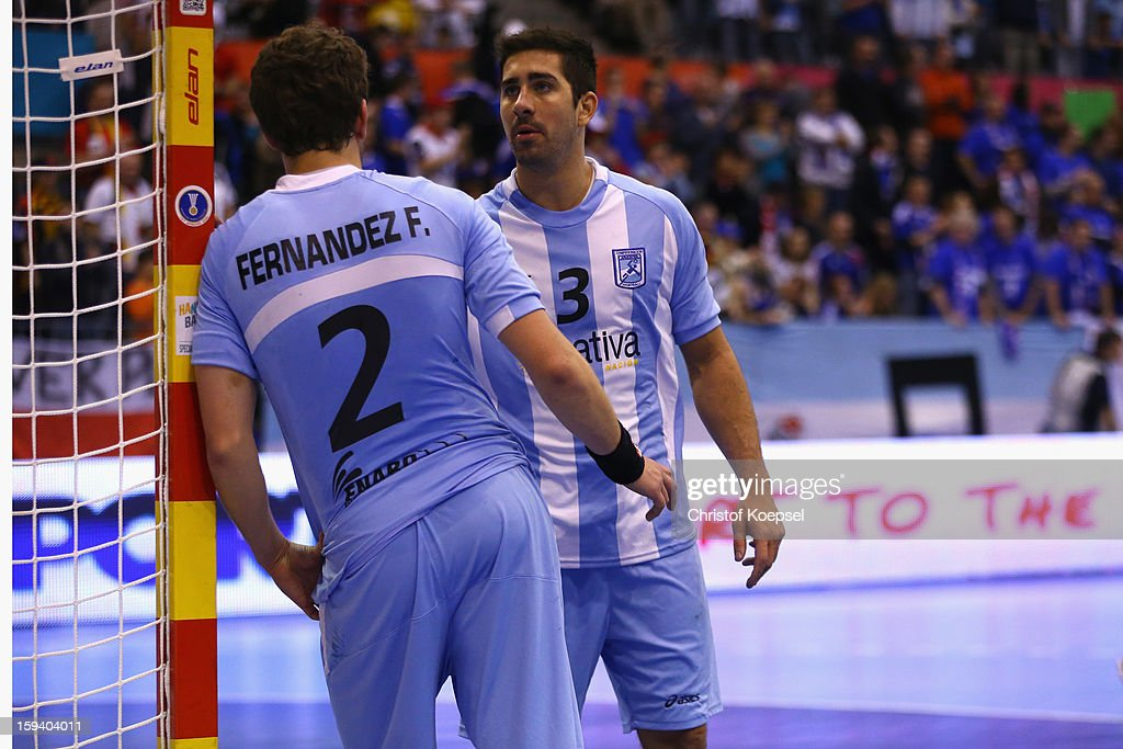 Frederico Fernandez and Frederico Pizarro of Argentina look dejected after losing 20-24 the premilary group A match between Brasil and Argentina and Montenegro at Palacio de Deportes de Granollers on January 13, 2013 in Granollers, Spain.
