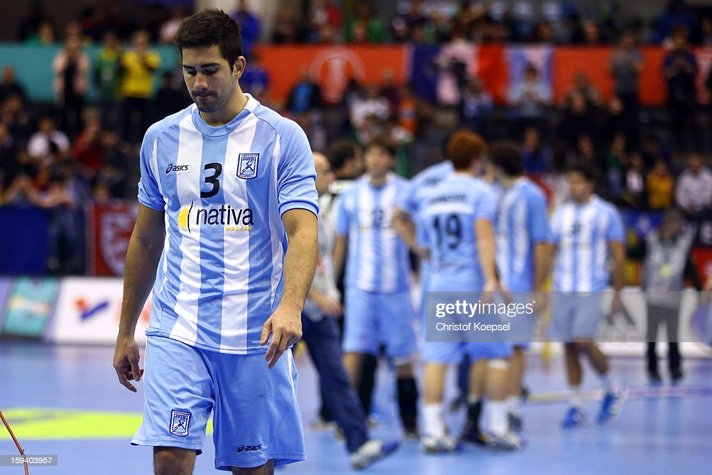 Frederico Pizarro of Argentina looks dejected after the premilary group A match between Brasil and Argentina and Montenegro at Palacio de Deportes de Granollers on January 13, 2013 in Granollers, Spain. The match between Brasil and Argentina ended 24-20.