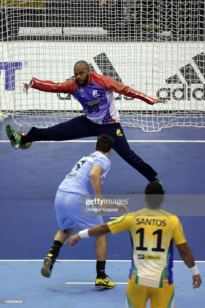 Frederico Pizarro of Argentina scoes a 7meter penalty against Cesar Almeida of Brazil during the premilary group A match between Brasil and Argentina and Montenegro at Palacio de Deportes de Granollers on January 13, 2013 in Granollers, Spain.