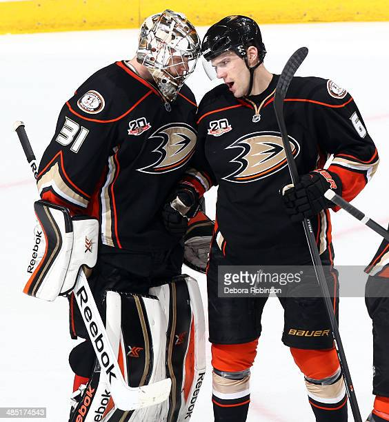 Frederik Andersen and Ben Lovejoy of the Anaheim Ducks celebrate the Ducks' 43 win over the Dallas Stars in Game One of the First Round of the 2014...