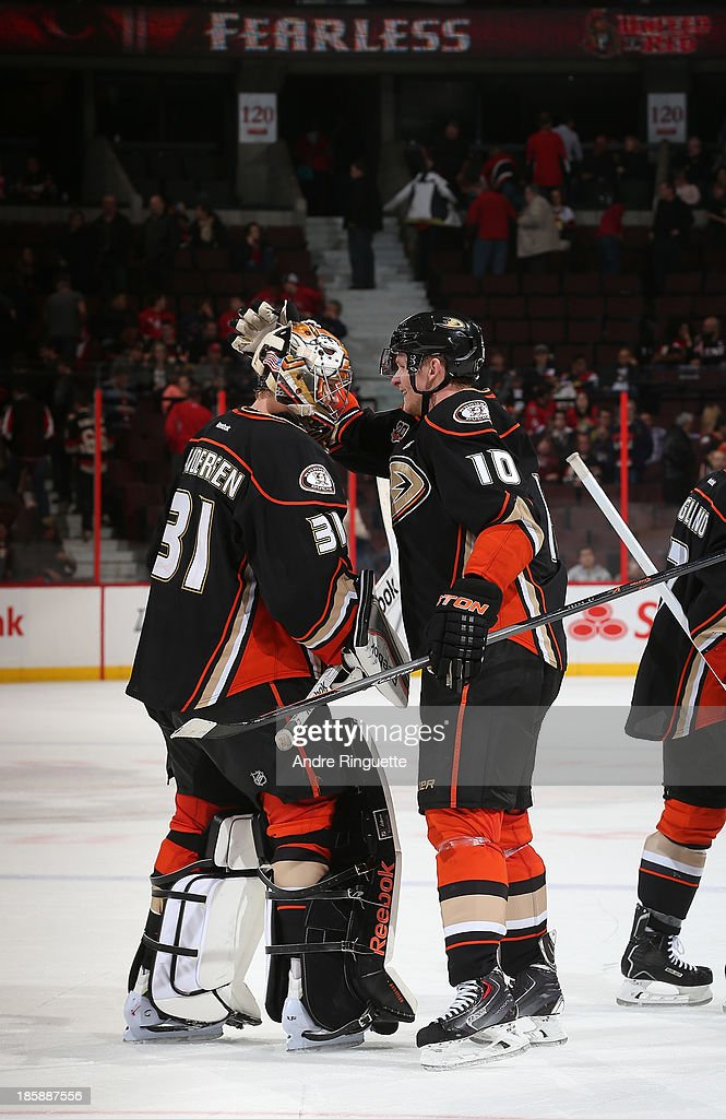 Frederik Andersen #31 and <a gi-track='captionPersonalityLinkClicked' href=/galleries/search?phrase=Corey+Perry&family=editorial&specificpeople=213864 ng-click='$event.stopPropagation()'>Corey Perry</a> #10 of the Anaheim Ducks celebrate their win against the Ottawa Senators at Canadian Tire Centre on October 25, 2013 in Ottawa, Ontario, Canada.