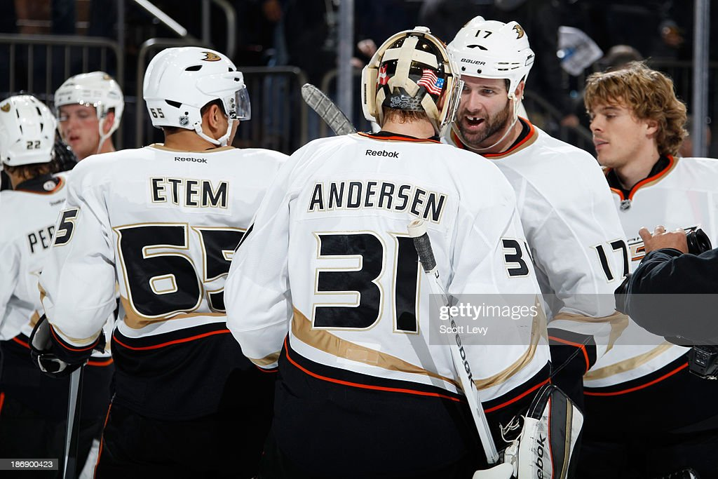 <a gi-track='captionPersonalityLinkClicked' href=/galleries/search?phrase=Frederik+Andersen&family=editorial&specificpeople=6605243 ng-click='$event.stopPropagation()'>Frederik Andersen</a> #31 and <a gi-track='captionPersonalityLinkClicked' href=/galleries/search?phrase=Dustin+Penner&family=editorial&specificpeople=589919 ng-click='$event.stopPropagation()'>Dustin Penner</a> #17 of the Anaheim Ducks celebrate a 2-1 win over the New York Rangers at Madison Square Garden on November 4, 2013 in New York City.