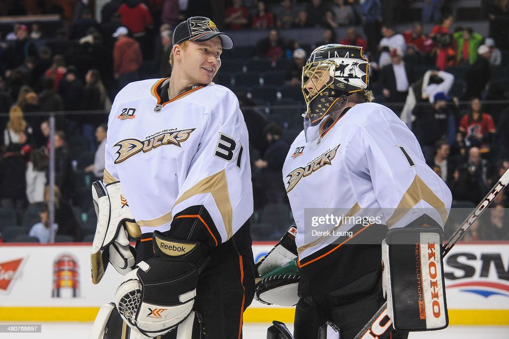 <a gi-track='captionPersonalityLinkClicked' href=/galleries/search?phrase=Frederik+Andersen&family=editorial&specificpeople=6605243 ng-click='$event.stopPropagation()'>Frederik Andersen</a> #31 (L) and <a gi-track='captionPersonalityLinkClicked' href=/galleries/search?phrase=Jonas+Hiller&family=editorial&specificpeople=743364 ng-click='$event.stopPropagation()'>Jonas Hiller</a> #1 of the Anaheim Ducks celebrate after defeating the Calgary Flames during an NHL game at Scotiabank Saddledome on March 26, 2014 in Calgary, Alberta, Canada. The Ducks defeated the Flames 3-2.