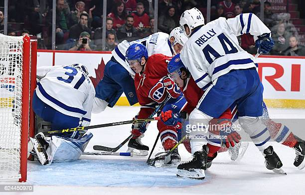 Frederik Andersen Morgan Rielly and Nikita Zaitsev of the Toronto Maple Leafs protect the net against Brendan Gallagher and Charles Hudon of the...
