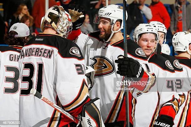 Frederik Andersen of the Anaheim Ducks is congratulated by teammate Patrick Maroon after defeating the New York Islanders at Nassau Veterans Memorial...