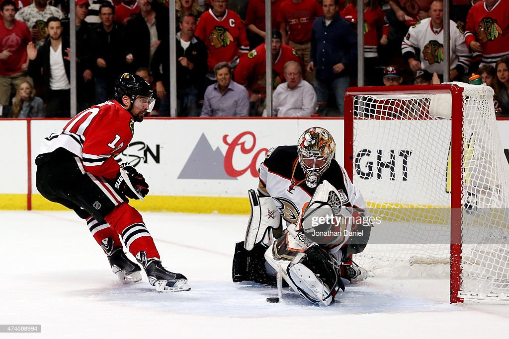<a gi-track='captionPersonalityLinkClicked' href=/galleries/search?phrase=Frederik+Andersen&family=editorial&specificpeople=6605243 ng-click='$event.stopPropagation()'>Frederik Andersen</a> #31 of the Anaheim Ducks makes a save against <a gi-track='captionPersonalityLinkClicked' href=/galleries/search?phrase=Patrick+Sharp&family=editorial&specificpeople=206279 ng-click='$event.stopPropagation()'>Patrick Sharp</a> #10 of the Chicago Blackhawks in the first overtime period of Game Four of the Western Conference Finals during the 2015 NHL Stanley Cup Playoffs at the United Center on May 23, 2015 in Chicago, Illinois.