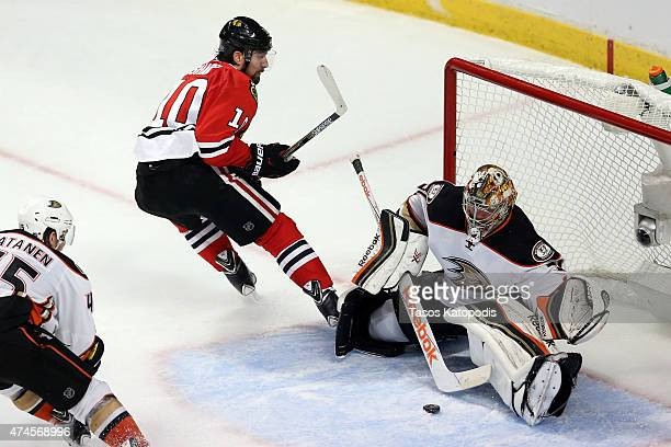 Frederik Andersen of the Anaheim Ducks makes a save against Patrick Sharp of the Chicago Blackhawks in the first overtime period of Game Four of the...