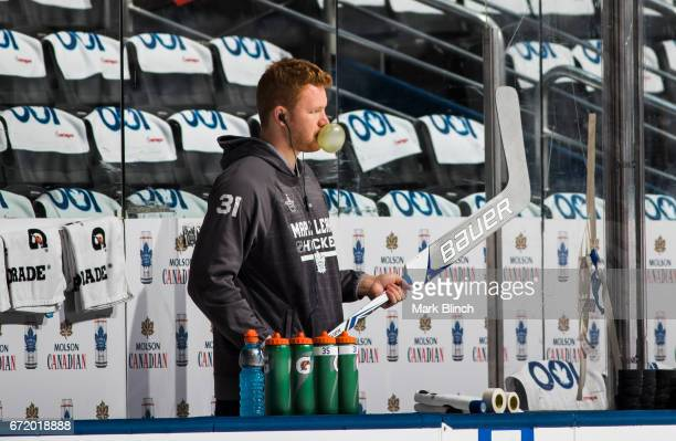 Frederik Andersen of the Toronto Maple Leafs blows a bubble while he prepares his stick before facing the Washington Capitals in Game Six of the...