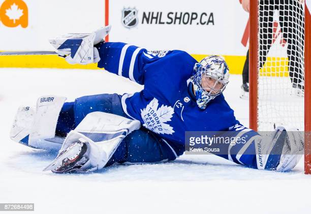 Frederik Andersen of the Toronto Maple Leafs covers his net against the Minnesota Wild during the third period at the Air Canada Centre on November 8...