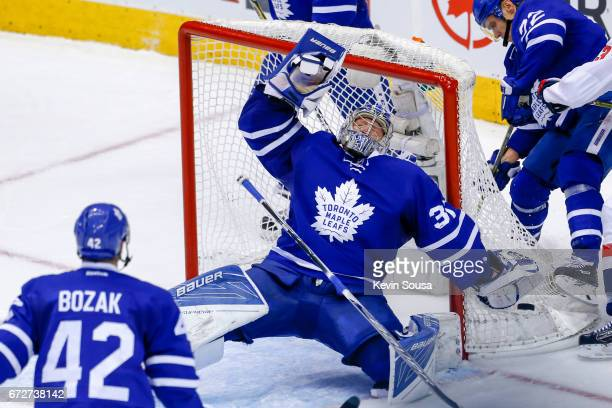 Frederik Andersen of the Toronto Maple Leafs falls back against the Washington Capitals during overtime in Game Six of the Eastern Conference First...