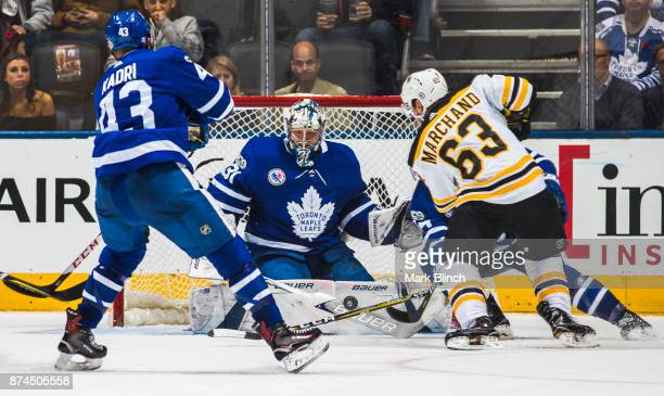 Frederik Andersen of the Toronto Maple Leafs guards the net against Brad Marchand of the Boston Bruins during the third period at the Air Canada...