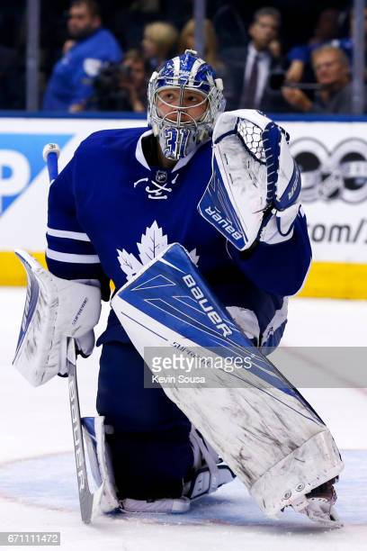 Frederik Andersen of the Toronto Maple Leafs looks for a deflected puck during the third period in Game Four of the Eastern Conference First Round...