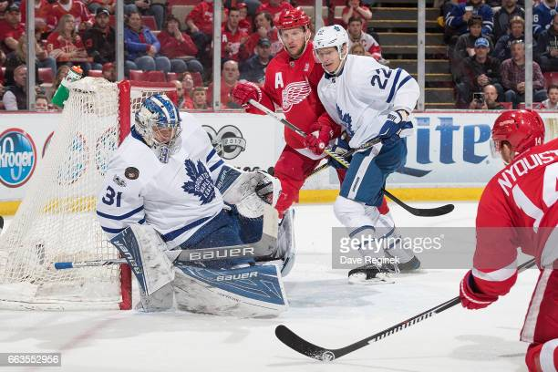 Frederik Andersen of the Toronto Maple Leafs makes a save on a shot by Gustav Nyquist of the Detroit Red Wings as Justin Abdelkader of the Wings...