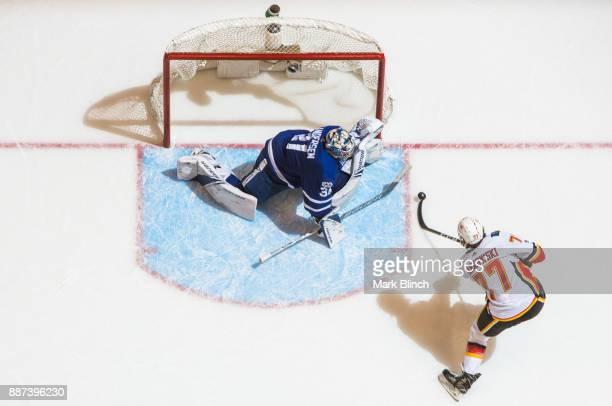 Frederik Andersen of the Toronto Maple Leafs makes a save on Mark Jankowski of the Calgary Flames during the third period at the Air Canada Centre on...