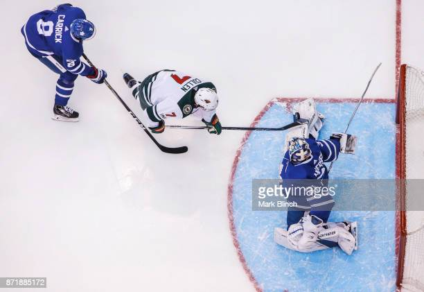Frederik Andersen of the Toronto Maple Leafs makes a save on Matt Cullen of the Minnesota Wild as Connor Carrick of the Toronto Maple Leafs defends...