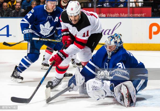 Frederik Andersen of the Toronto Maple Leafs makes a stick save against Brian Boyle of the New Jersey Devils during the third period at the Air...