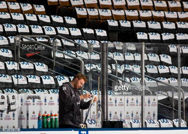 Frederik Andersen of the Toronto Maple Leafs prepares his stick before facing the Washington Capitals in Game Six of the Eastern Conference First...