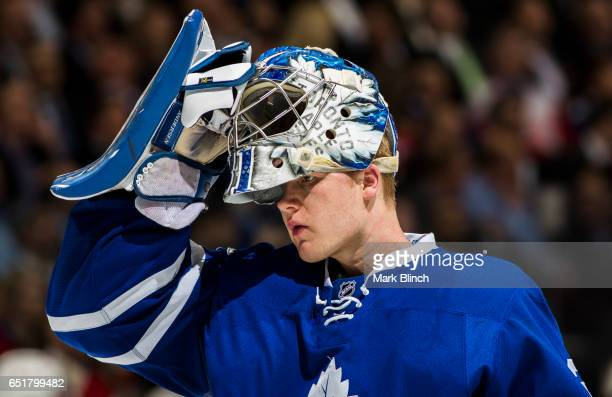 Frederik Andersen of the Toronto Maple Leafs puts on his goalie mask while playing the Detroit Red Wings during the second period at the Air Canada...
