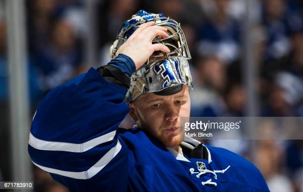 Frederik Andersen of the Toronto Maple Leafs puts on his helmet in a break against the Washington Capitals during the second period in Game Four of...