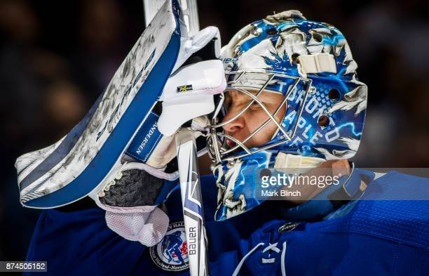 Frederik Andersen of the Toronto Maple Leafs puts on his mask in a break in play against the Boston Bruins during the second period at the Air Canada...