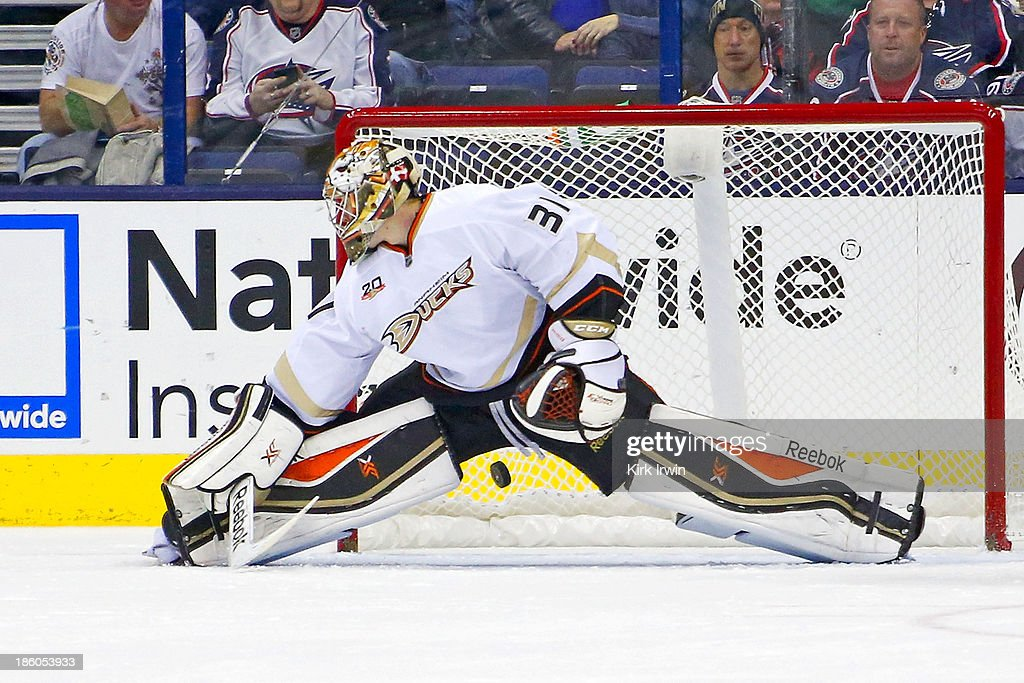 Frederik Anderson #31 of the Anaheim Ducks is unable to stop the shot from Blake Comeau #14 of the Columbus Blue Jackets during the first period on October 27, 2013 at Nationwide Arena in Columbus, Ohio. The goal was Comeau's first goal of the season.