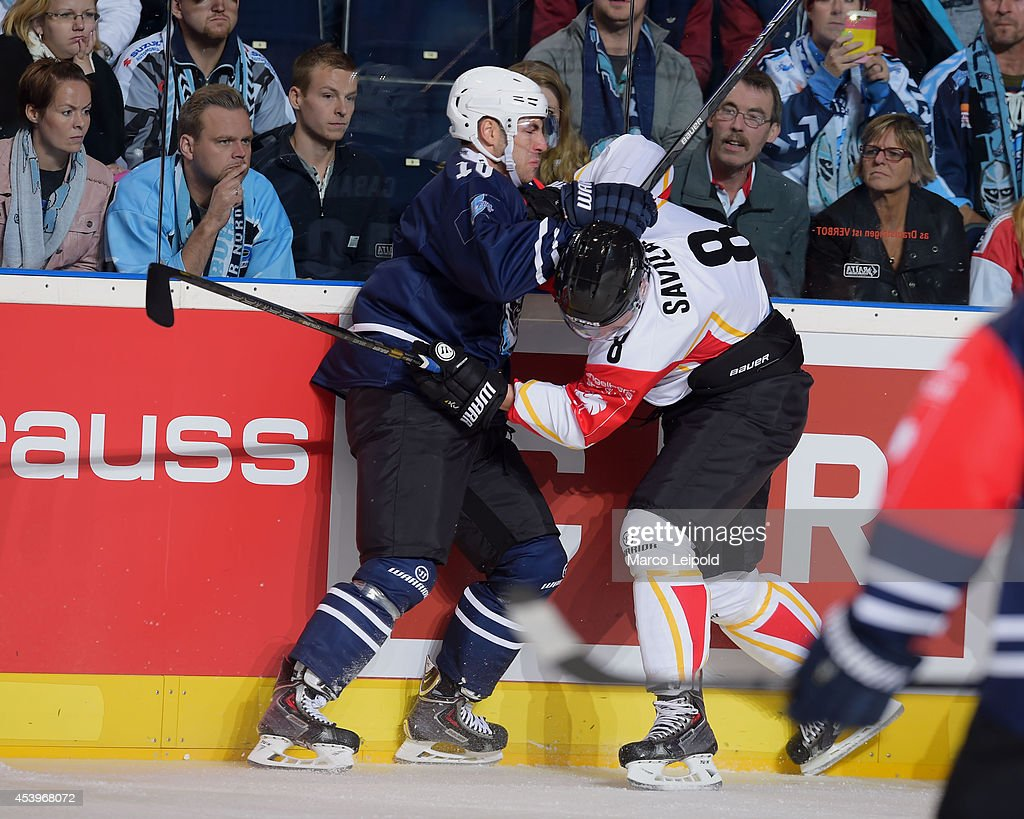 Frederik Cabana #10 of Hamburg Freezers and Per Savilahti-Nagander #8 of Lulea Hockey fight during the Champions Hockey League group stage game between Hamburg Freezers and Lulea HF on August 22, 2014 in Hamburg, Germany.