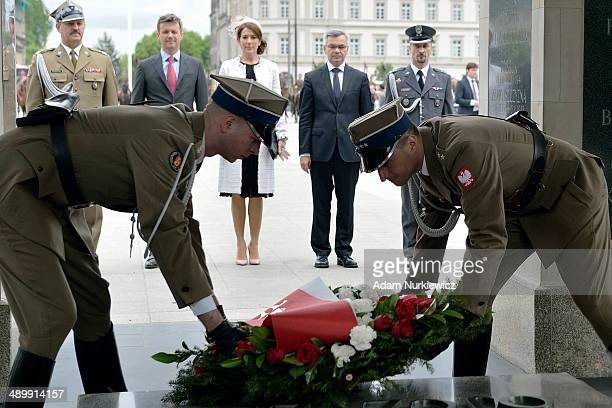 Frederik Crown Prince of Denmark and his wife Crown Princess Mary speak during their visit to the Tomb of the Unknown Soldier as part of their trip...