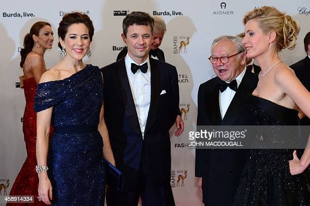 Frederik Crown Prince of Denmark and his wife Mary Crown Princess of Denmark pose with German publisher Hubert Burda and his wife German actress...