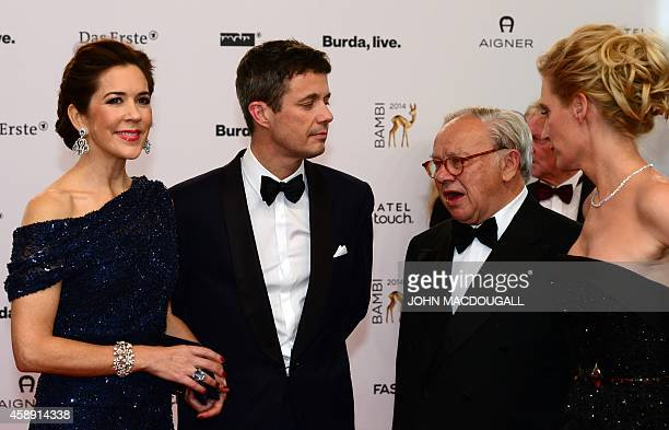 Frederik Crown Prince of Denmark and his wife Mary Crown Princess of Denmark talk with German publisher Hubert Burda and his wife German actress...