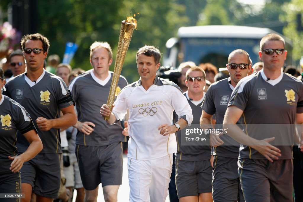 Frederik, Crown Prince of Denmark, carrries the Olympic Torch through Central London on July 26, 2012 in London, England.The Olympic flame is making its way through the capital on the penultimate day of its journey around the UK before arriving in the Olympic Stadium on Friday evening for the Olympic games' Opening Ceremony