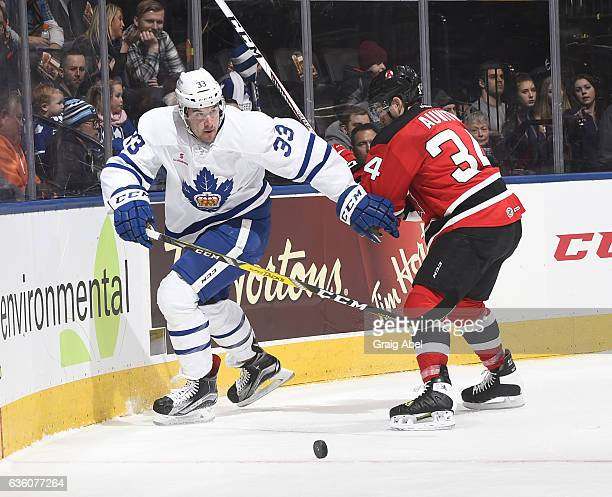 Frederik Gauthier of the Toronto Marlies controls the puck against Yohann Auvitu of the Albany Devils during AHL game action on December 17 2016 at...