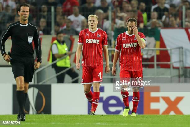 Frederik Hillesborg Sorensen of Koeln Matthias Lehmann of Koeln Jhon Andres Cordoba Copete of Koeln looks dejected during the UEFA Europa League...