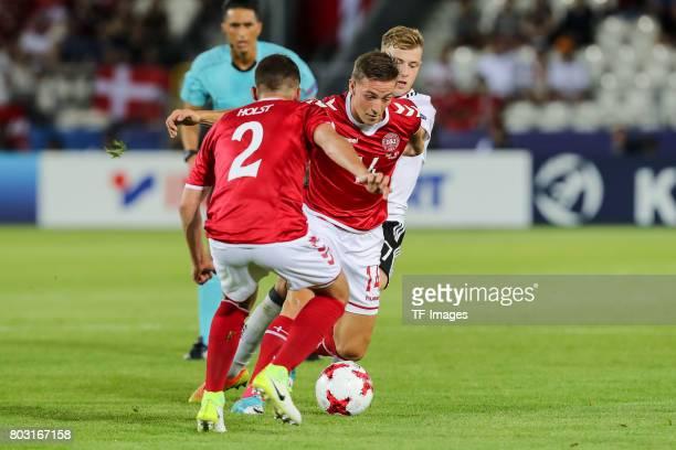 Frederik Holst of Denmark Casper Nielsen of Denmark and Max Meyer of Germany battle for the ball during the UEFA European Under21 Championship Group...