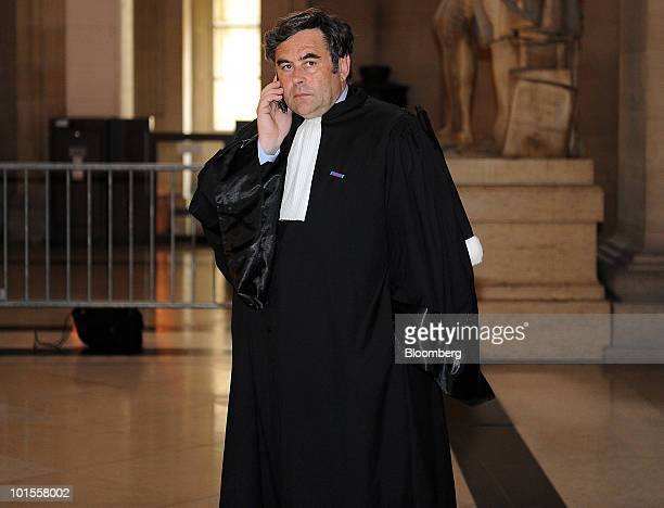 Frederik KarelCanoy lawyer and president of APPAC a group representing small shareholders uses his cell phone at the Vivendi SA insider trading trial...