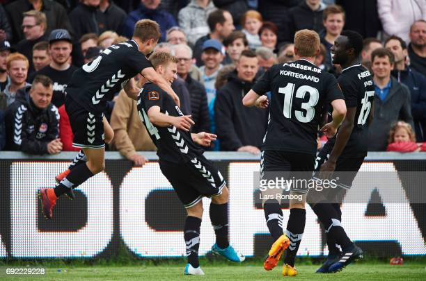 Frederik Moller and Jonas Gemmer of AC Horsens celebrate after scoring their third goal during the Danish Alka Superliga Playoff match between...