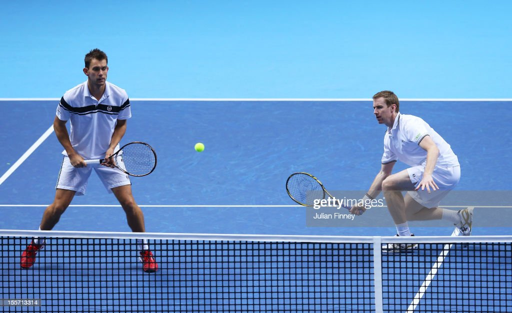 Frederik Nielsen of Denmark and Jonathan Marray of Great Britain in action during the men's doubles match against Max Mirnyi of Belarus and Daniel...