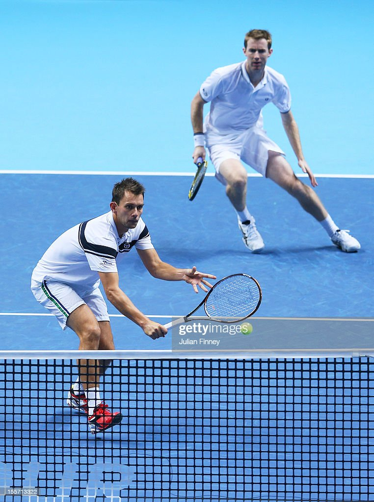 Frederik Nielsen of Denmark and Jonathan Marray of Great Britain talk tactics during the men's doubles match against Max Mirnyi of Belarus and Daniel...