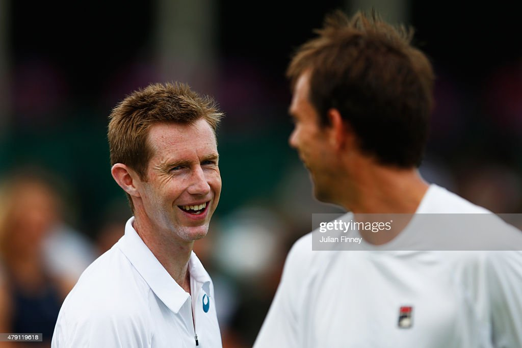 Frederik Nielsen of Denmark and Jonathan Marray of Great Britain talk tactics in their Gentlesmens Doubles First Round match against Fabrice Martin...
