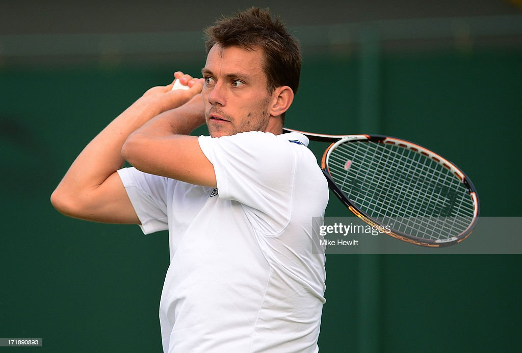 Frederik Nielsen of Denmark plays a backhand during their Gentlemen's Doubles second round match between Grigor Dimitrov of Bulgaria and Frederik...