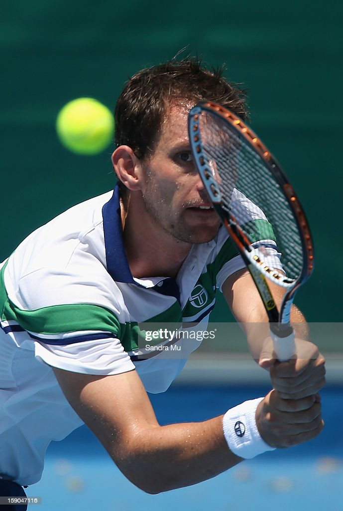 Frederik Nielsen of Denmark plays a backhand in his first round match against Jesse Levine of Canada during day one of the Heineken Open at ASB...