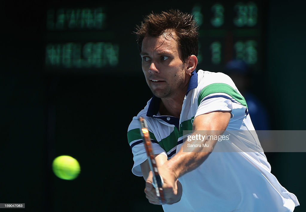 Frederik Nielsen of Denmark plays a forehand in his first round match against Jesse Levine of Canada during day one of the Heineken Open at ASB...