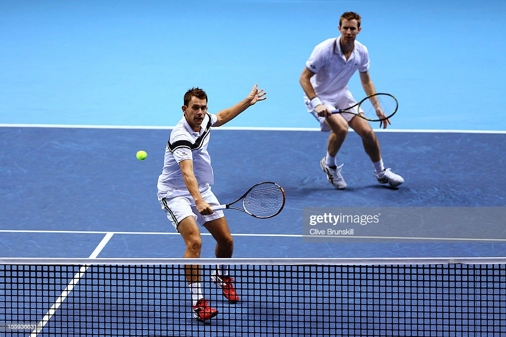 Frederik Nielsen of Denmark returns a shot next to Jonathan Marray of Great Britain during their men's doubles match against Robert Lindstedt of...