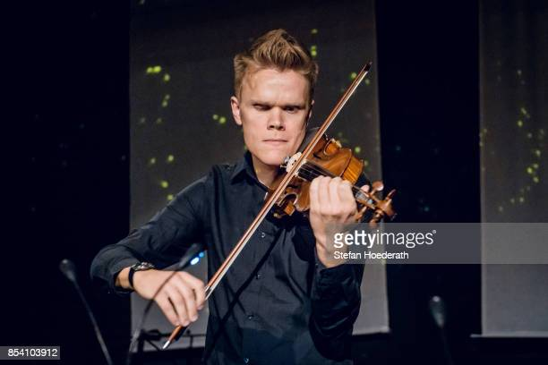 Frederik Oland of Danish String Quartett performs live on stage during Yellow Lounge x Reeperbahn Festival organized by recording label Deutsche...