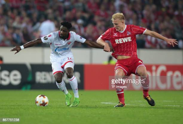 Frederik Soerensen of Koeln and Richmond Y Boakye of Belgrad battle for the ball during the UEFA Europa League group H match between 1 FC Koeln and...