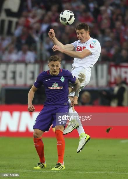Frederik Soerensen of Koeln and Robert Bauer of Bremen battle for the ball during to the Bundesliga match between 1 FC Koeln and Werder Bremen at...